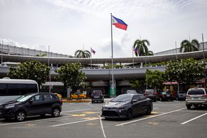Cars parked at a Manila airport terminal