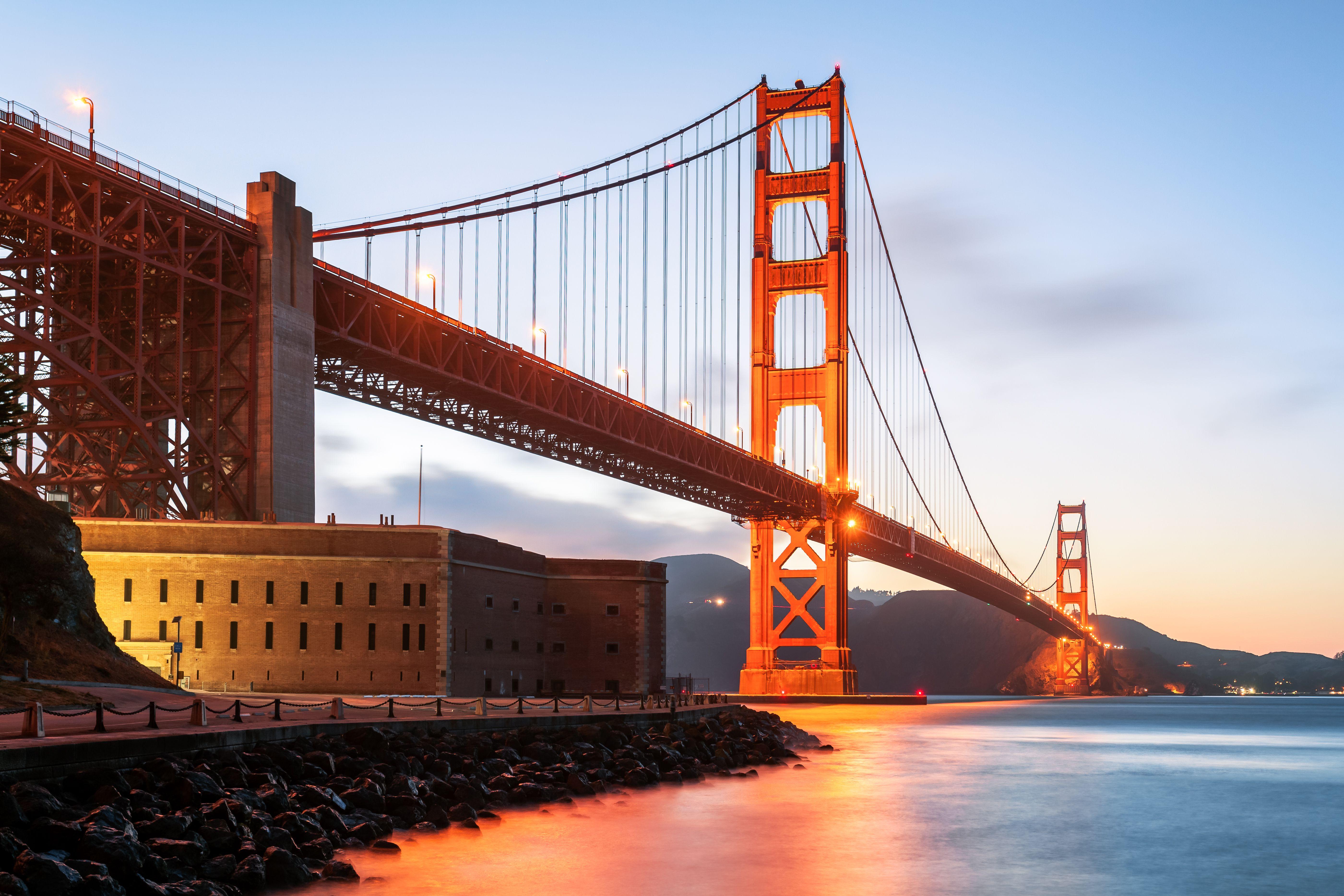 Fort below Golden Gate Bridge at sunset