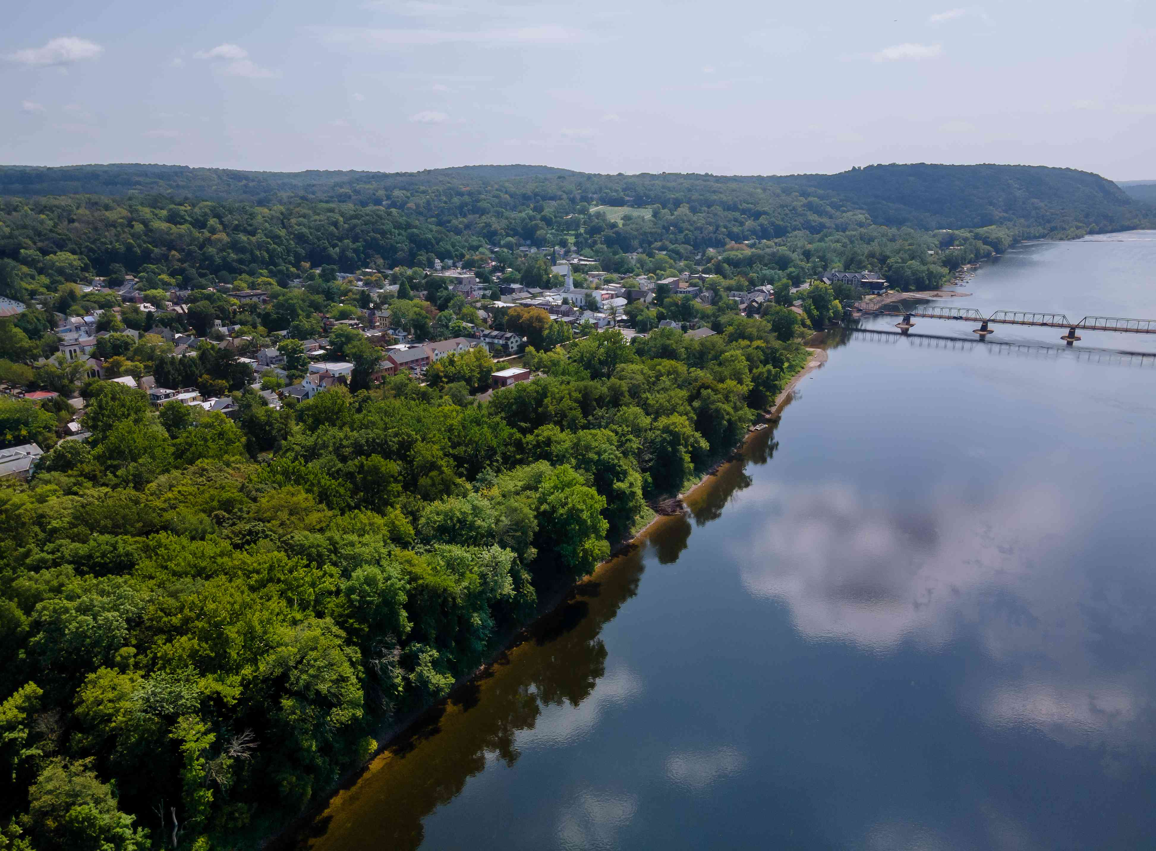 Aerial overhead of Delaware river landscape, American town of Lambertville New Jersey, view near small town historic New Hope Pennsylvania USA