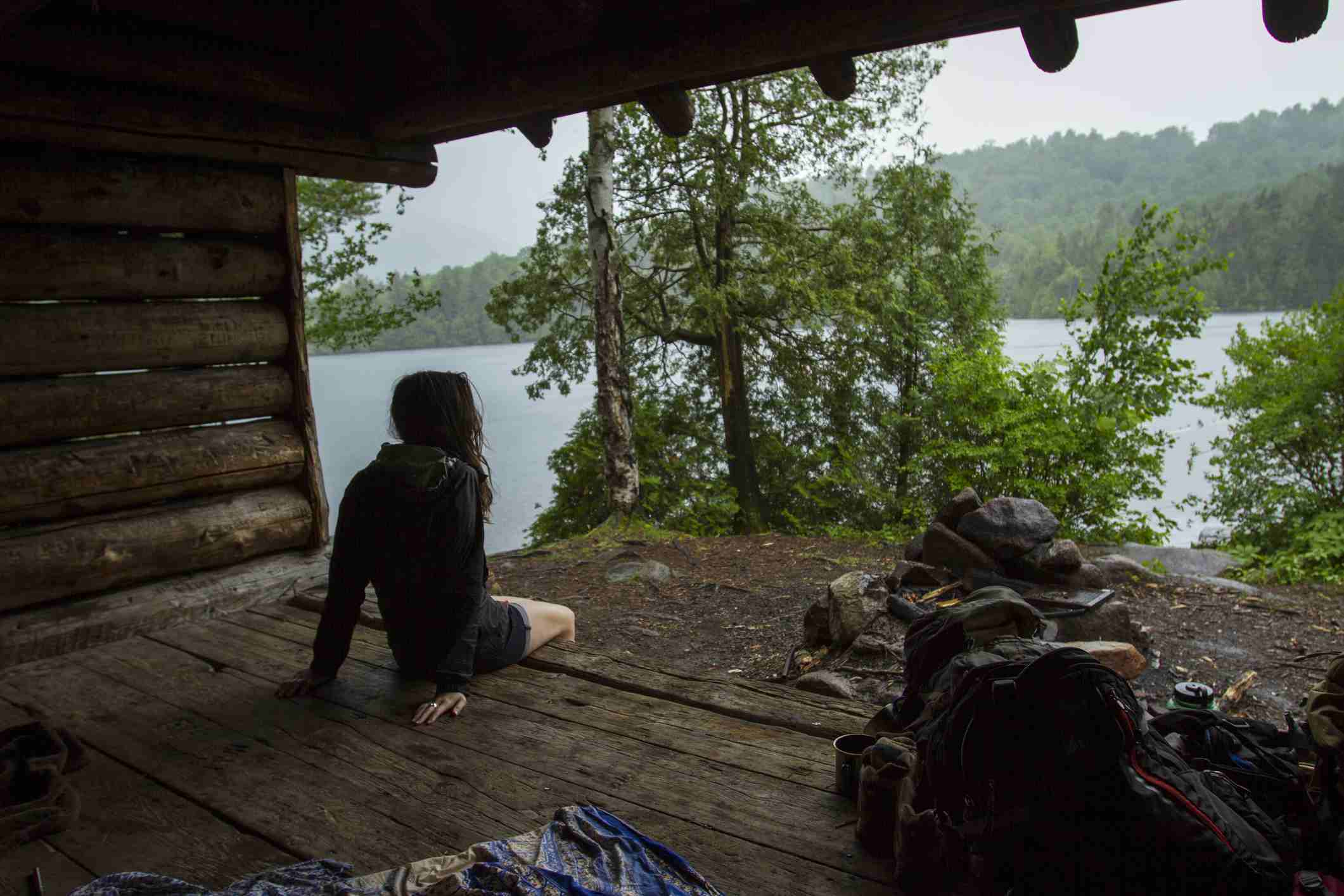 Woman camping in the Adirondack Mountains