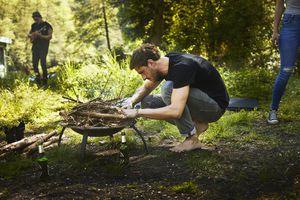 Man preparing a campfire in a brazier