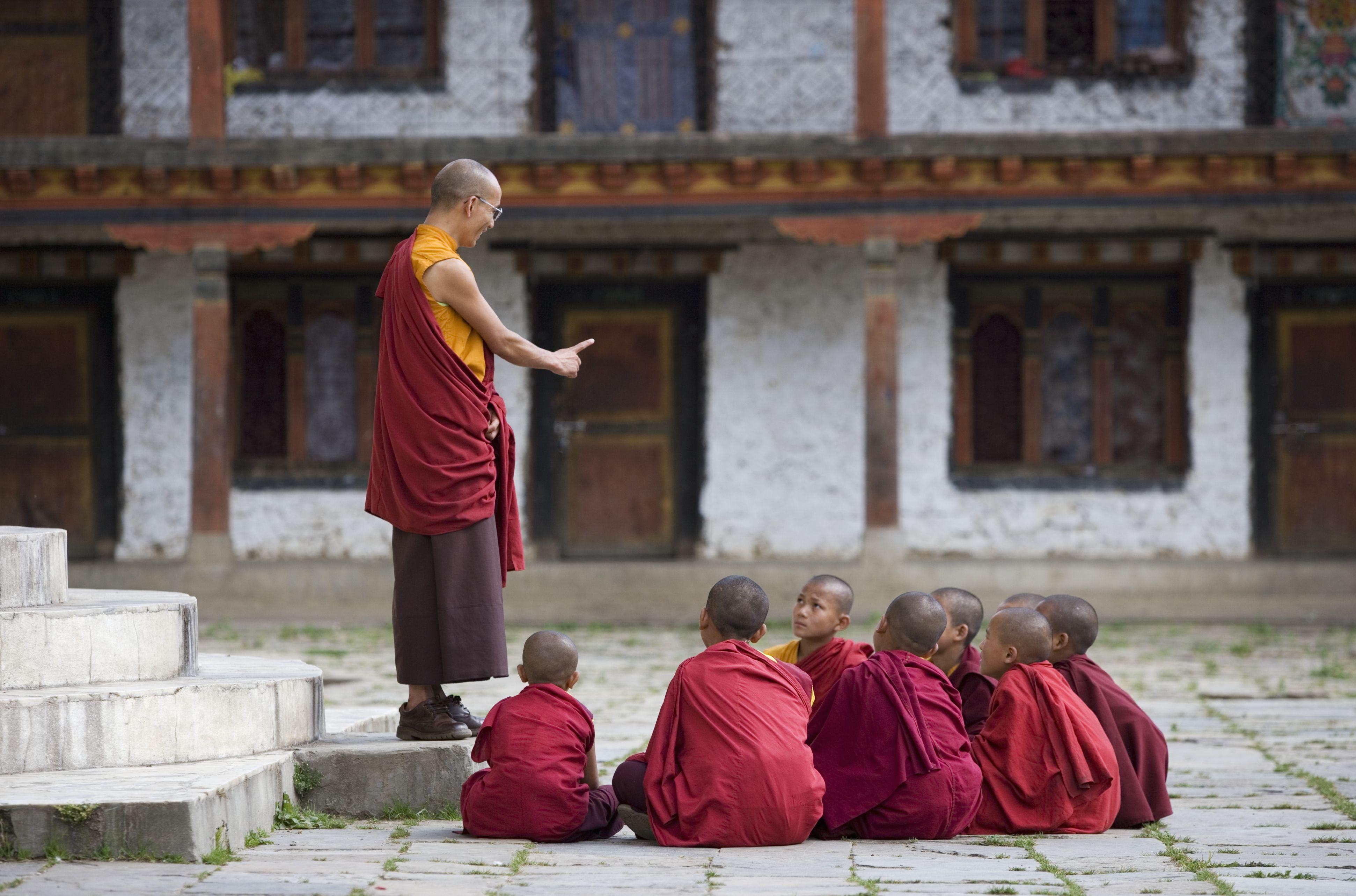 A lama teaches at Karchu Dratsang Monastery, Bhutan.