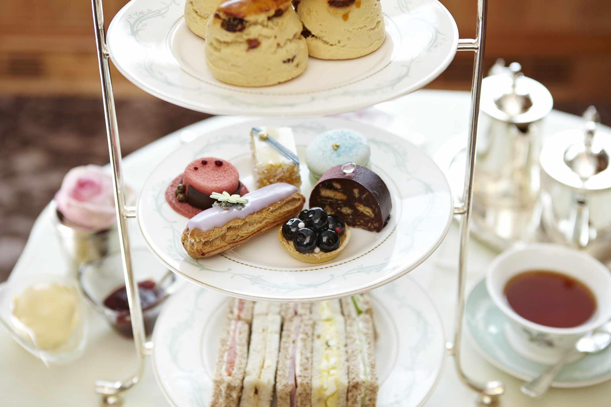 Afternoon tea with scones, cakes, jam and cream