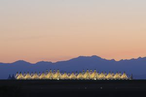 Denver International Airport at dusk with a mountain background