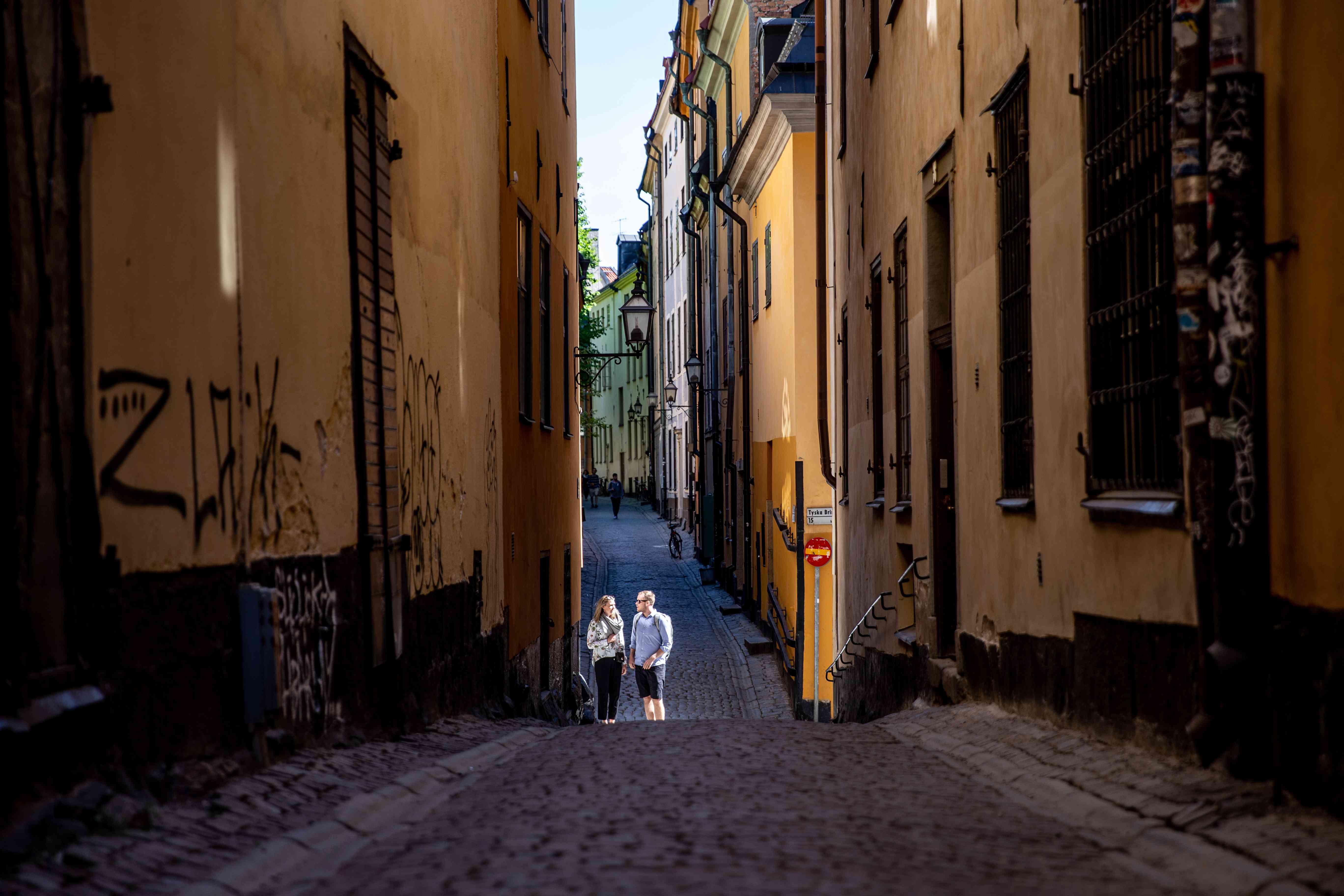 Two people wandering down alleys in Gamla Stan