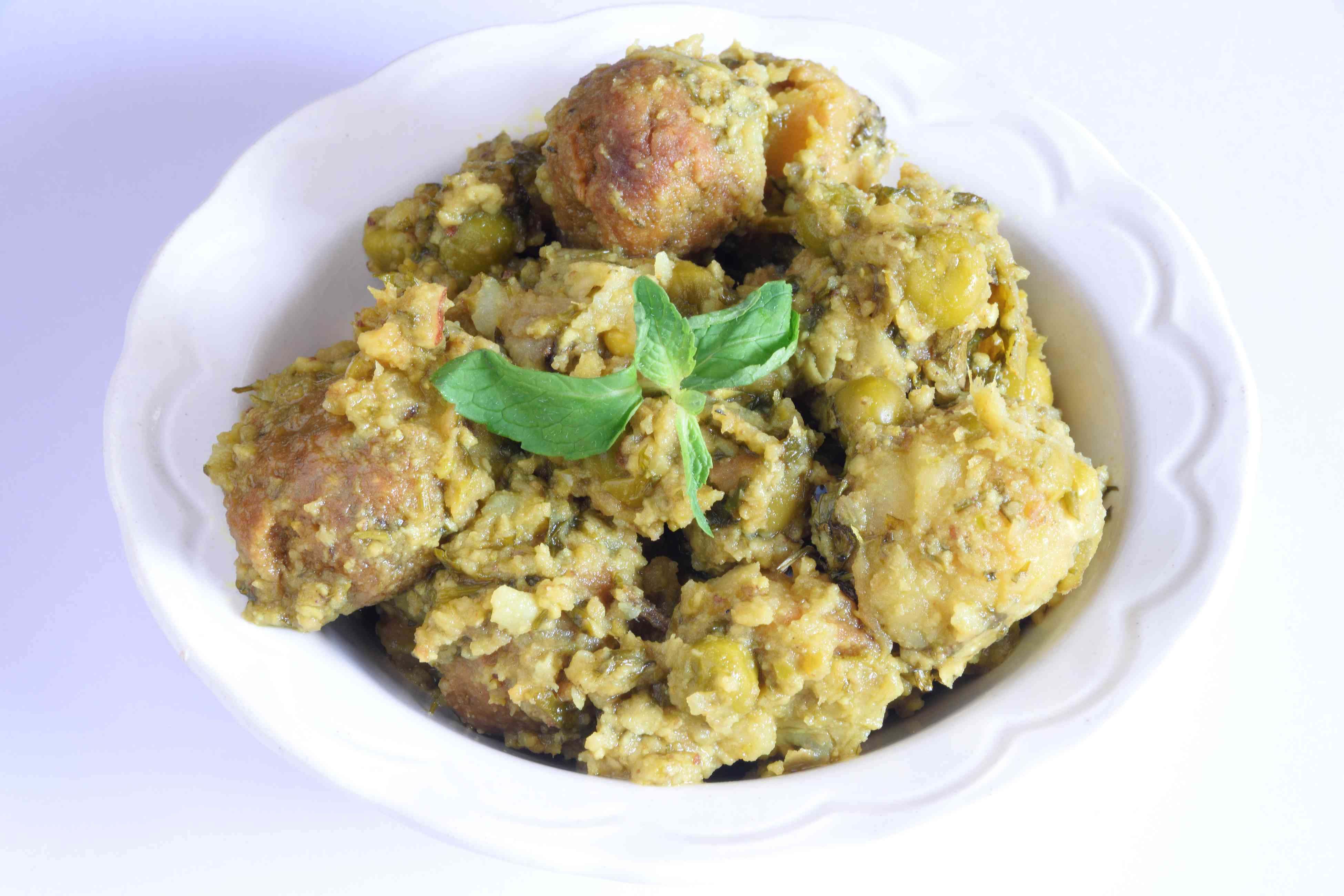 Undhiyu, a traditional extremely popular vegetarian (vegan) dish from state of Gujarat in India
