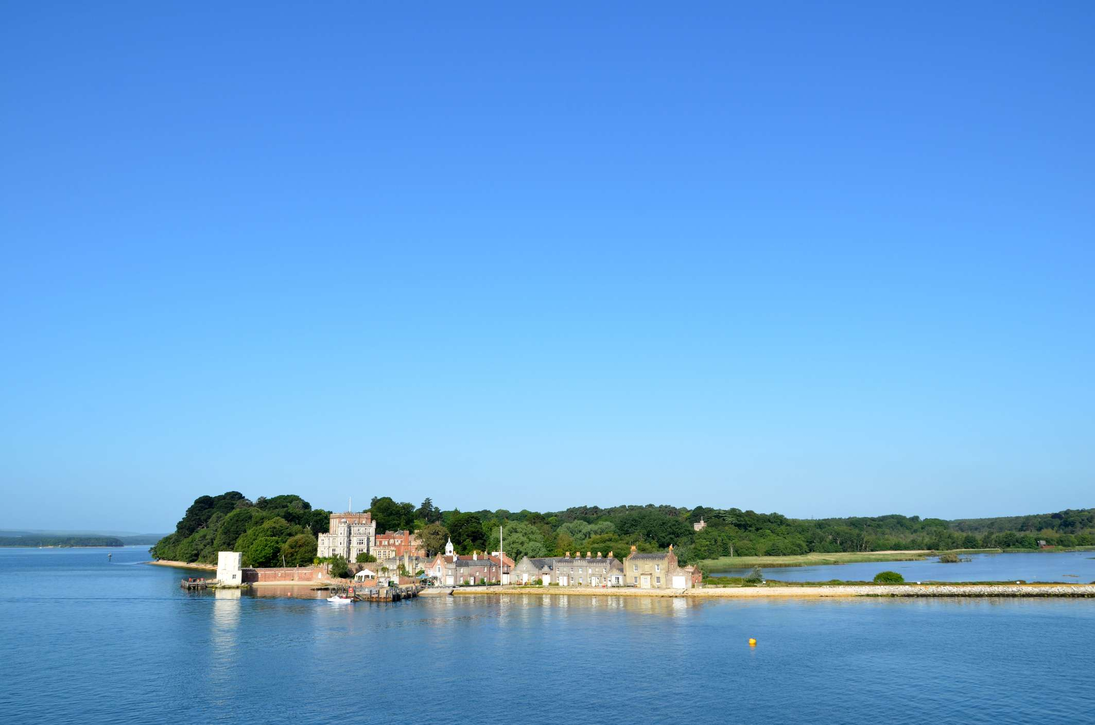 Distant view of buildings and trees onBrownsea Island