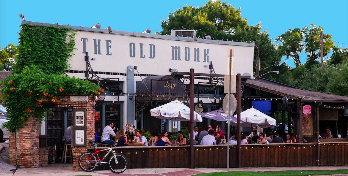 exterior of the Old Monk with people sitting on the outdoor patio