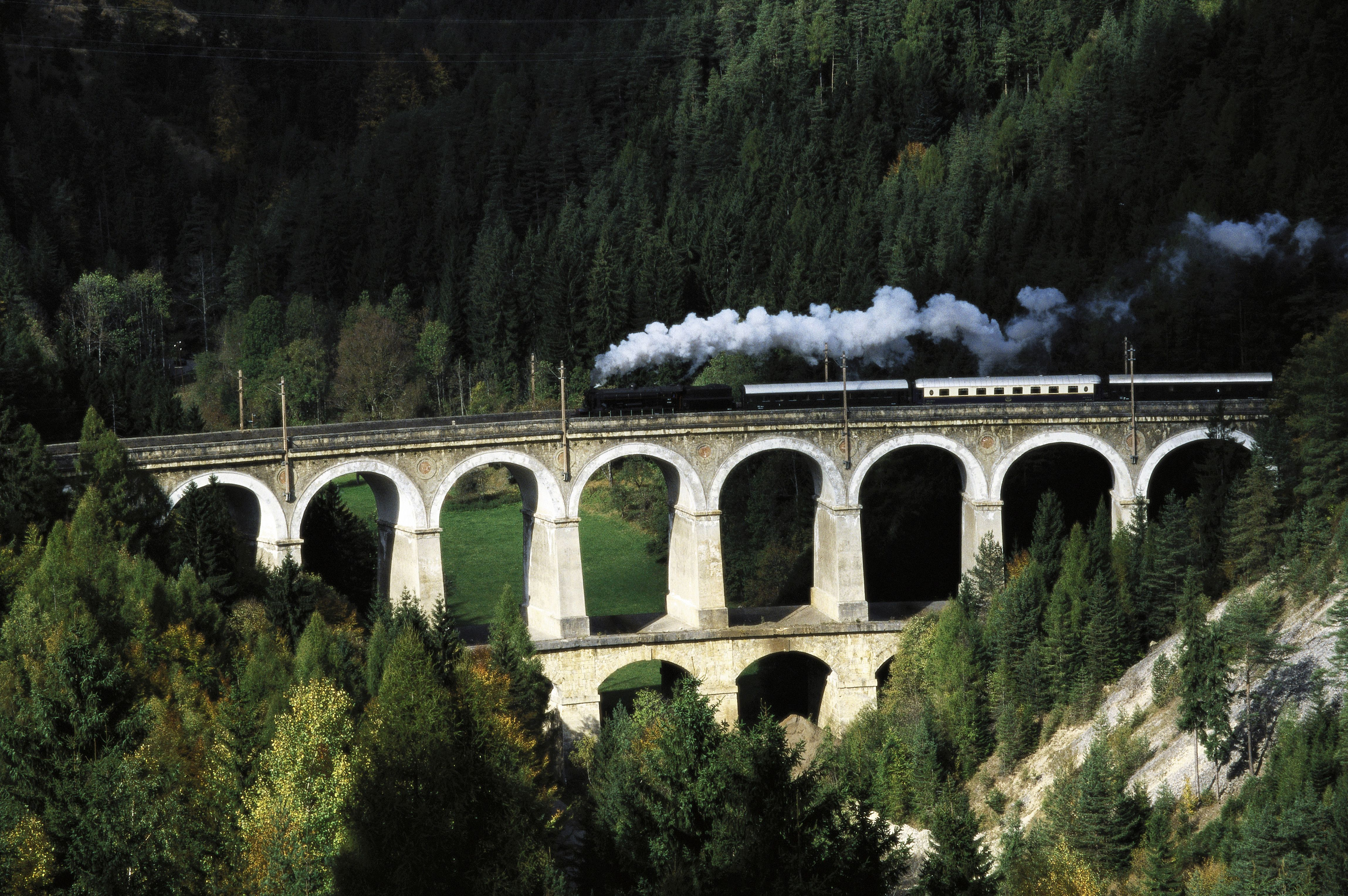 Semmering railway, ancient steamer on viaduct over Kalte Rinne, Semmering, Lower Austria. Photography, about 1999.