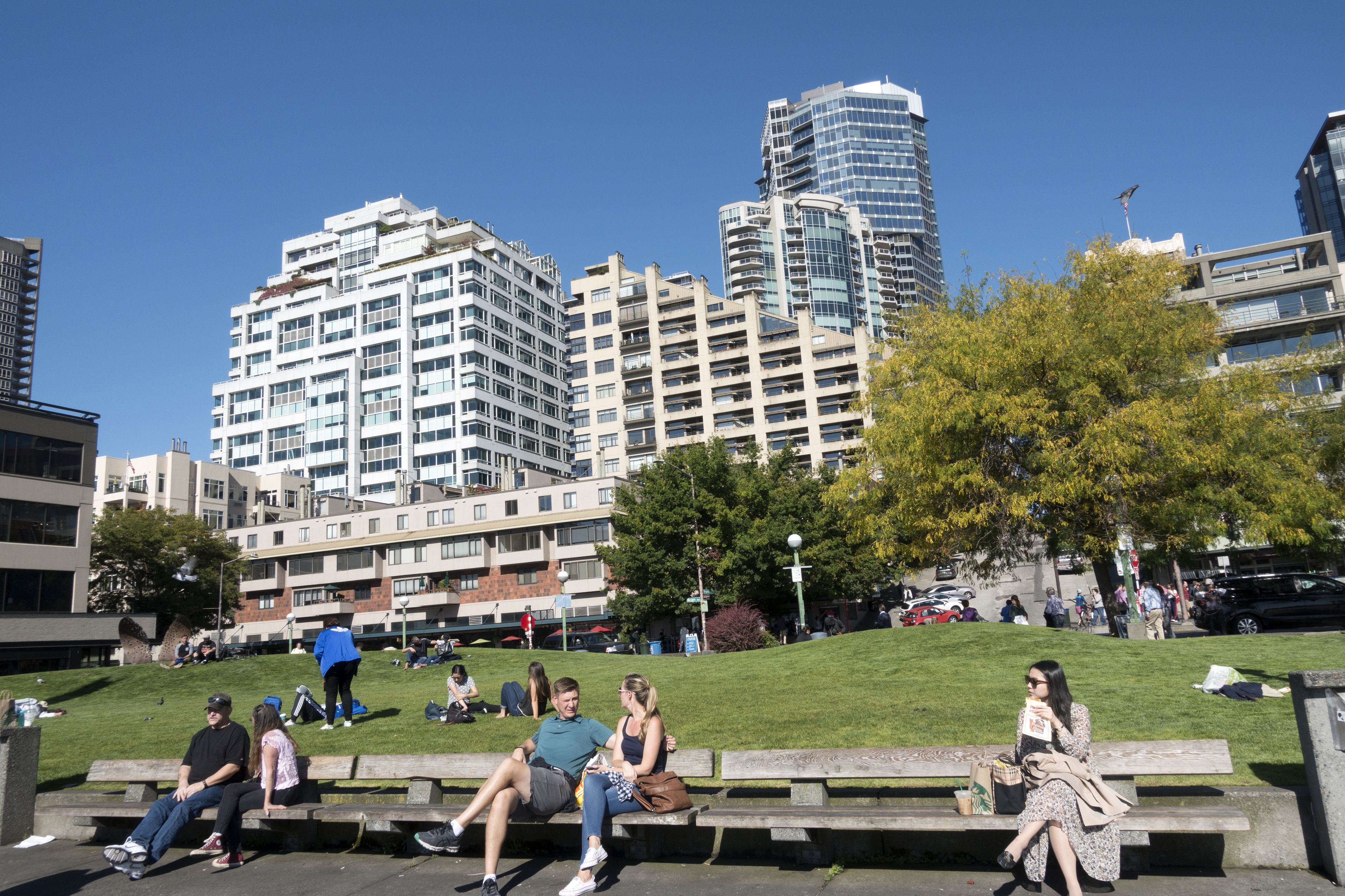 People relaxing at Victor Steinbrueck Park in downtown Seattle