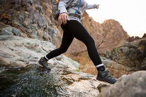 Trekker running in Death Valley National Park, California, US - stock photo