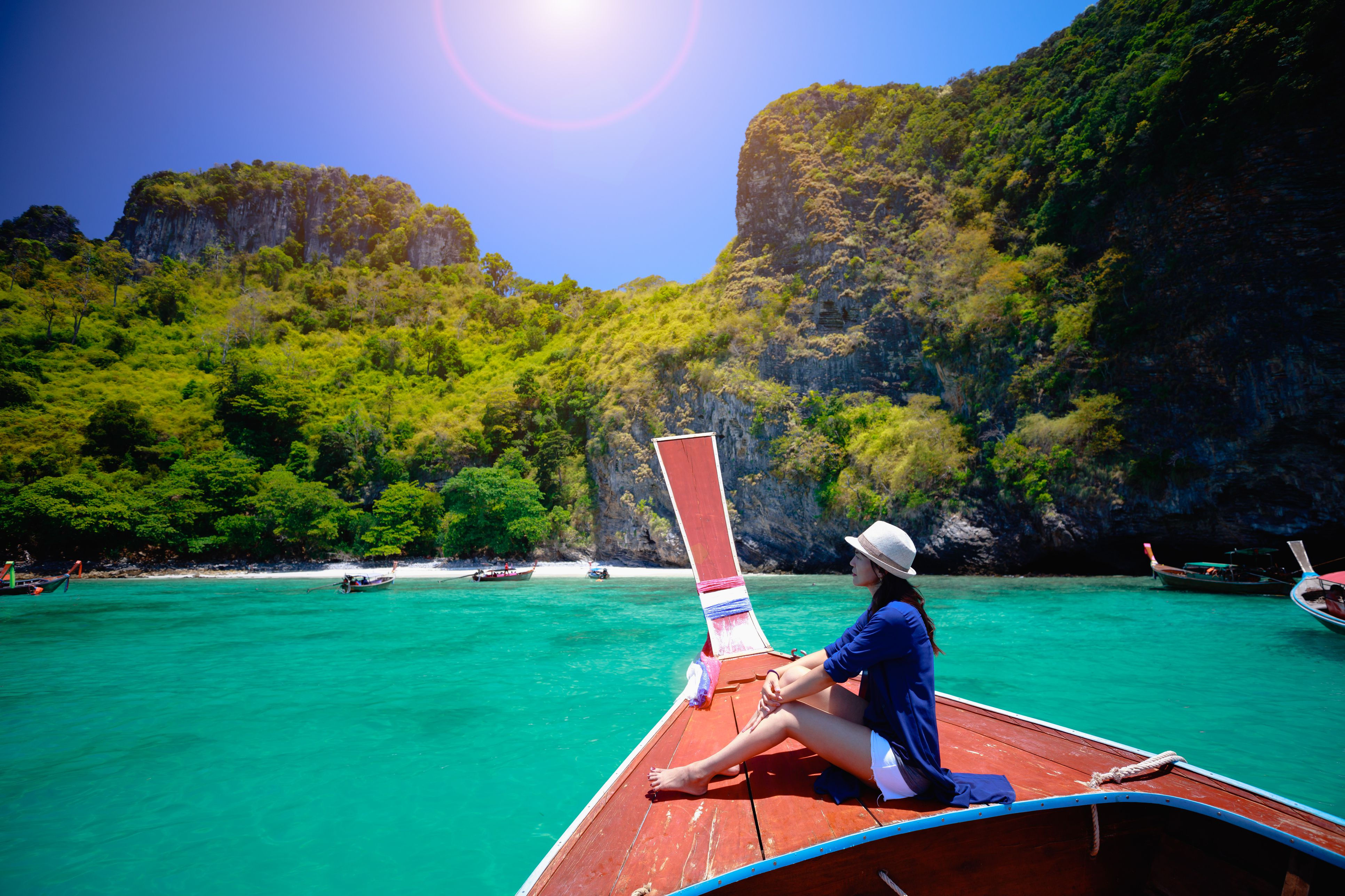 Female traveler on a boat in Thailand