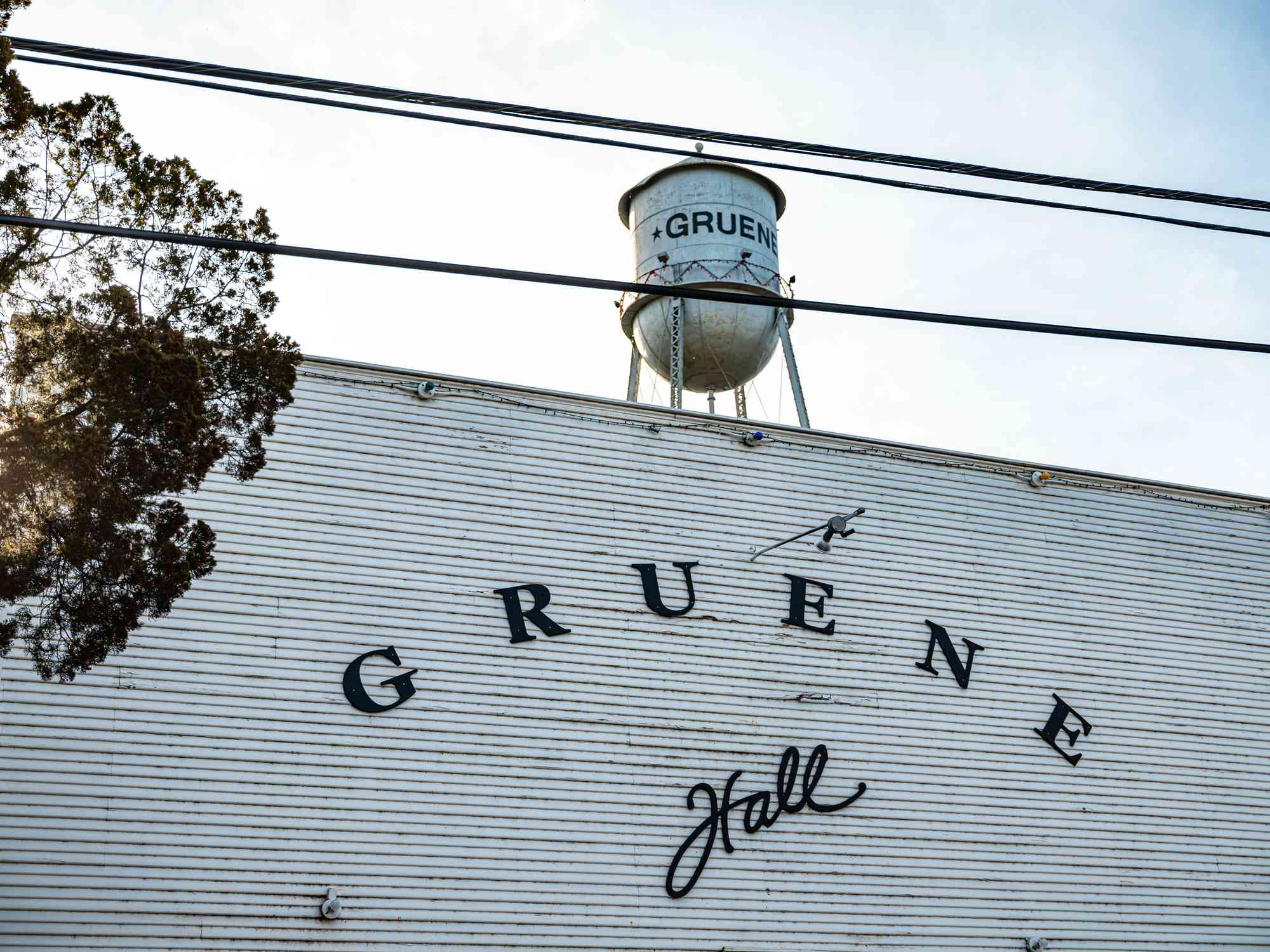 Exterior of famous Gruene Hall, local dance and music hall with old fashioned water tower in the background.