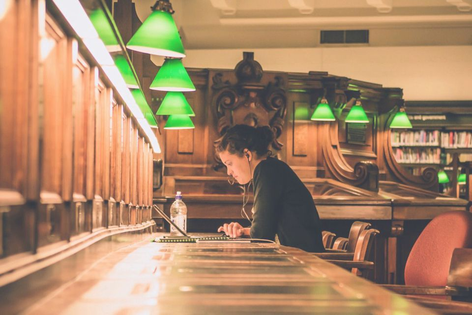 woman studying in a college library