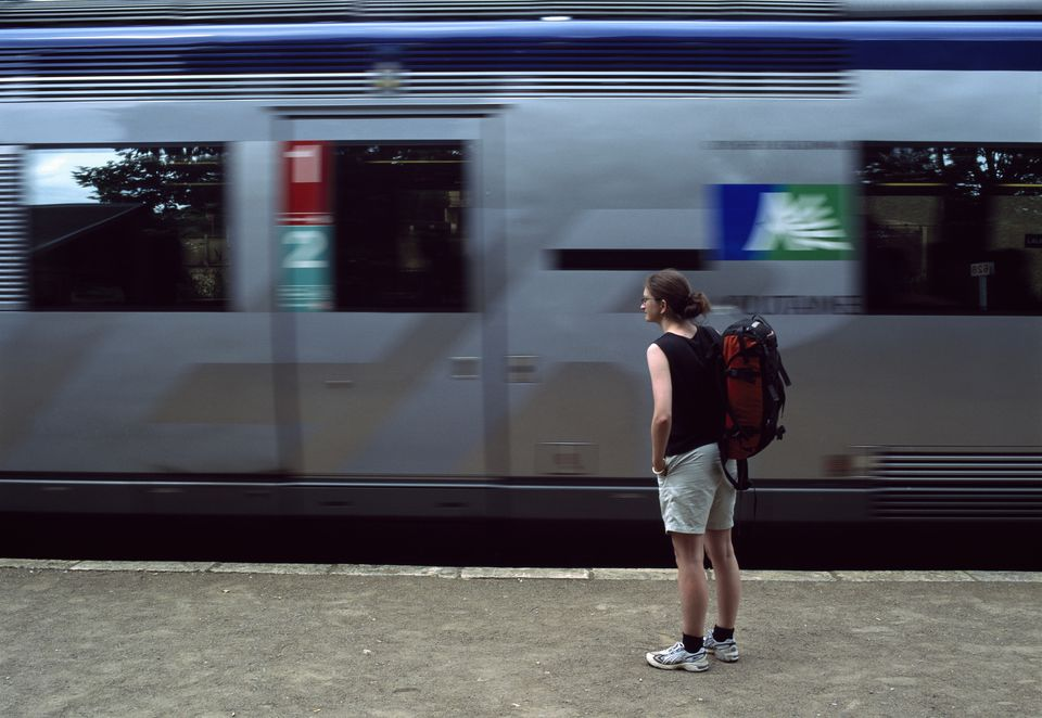 Tourist waiting to board train at Lalinde station