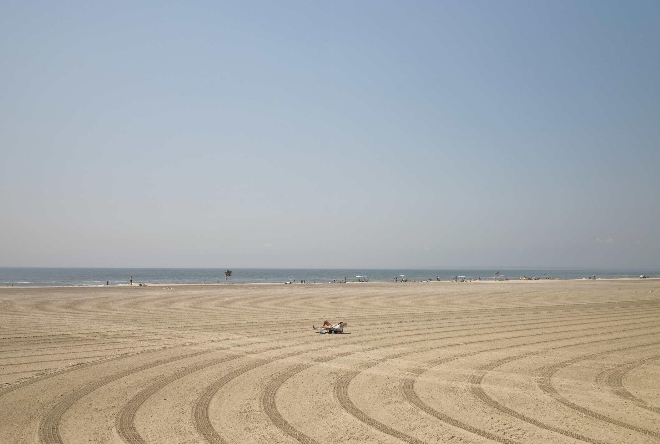 Tyre tracks on beach