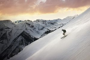 Mid adult man skiing down mountain, Golden, British Columbia, Canada
