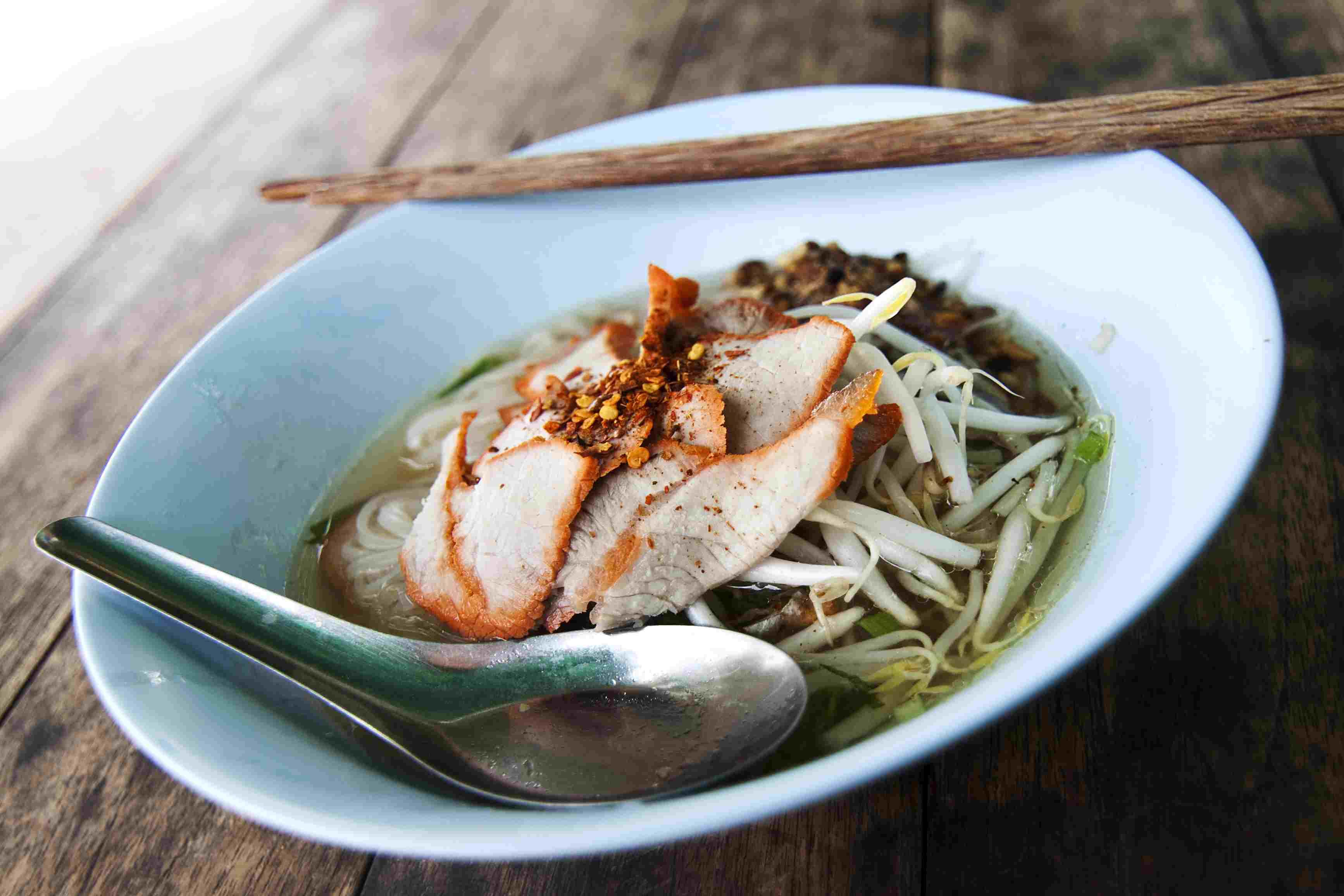Sukhothai noodle soup with utensils