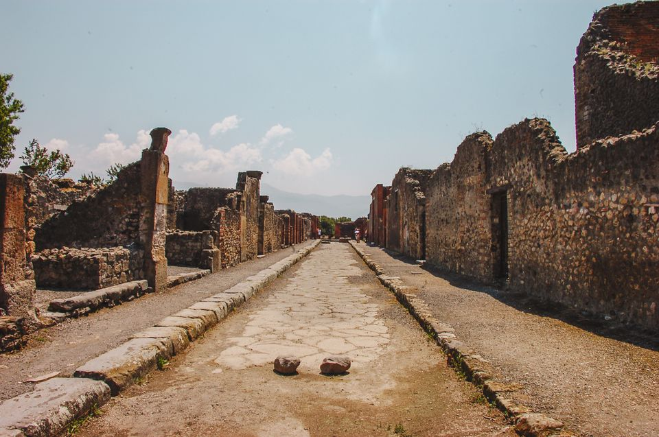 A walkway through Pompeii ruins