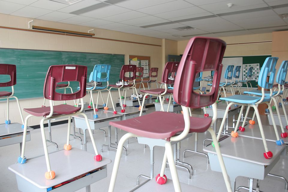 Classroom with chairs, desks and blackboard.