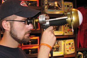 In the Harry Potter books and films, Omnioculars are used like binoculars to magnify viewing.