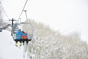 Couple riding ski lift