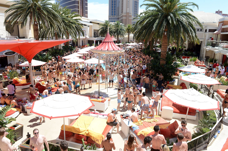 Crowd of people milling around a pool at Encore Beach Club, At Wynn Las Vegas