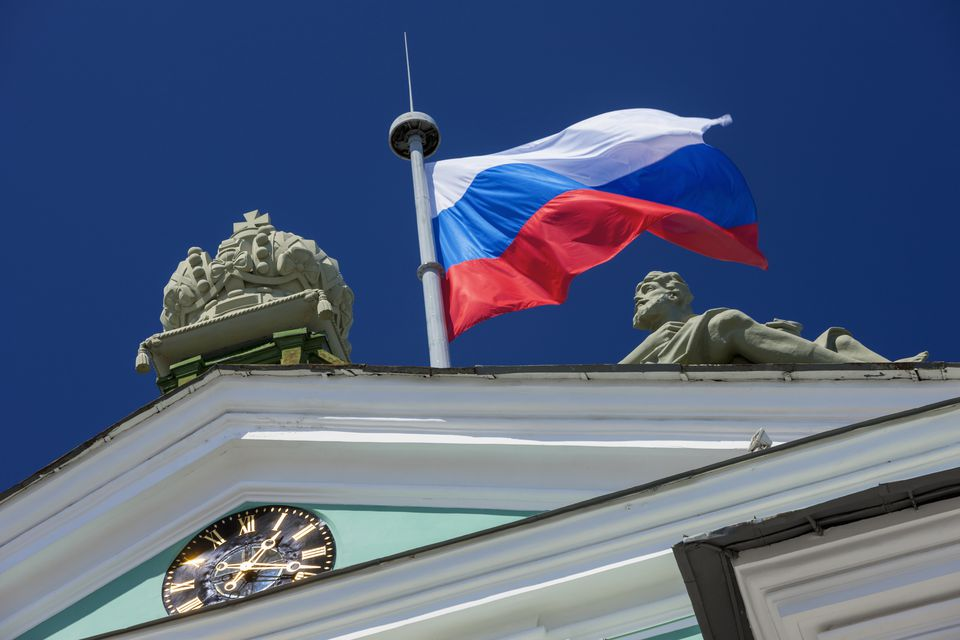 The Russian flag flying on top of the State Hermitage Museum