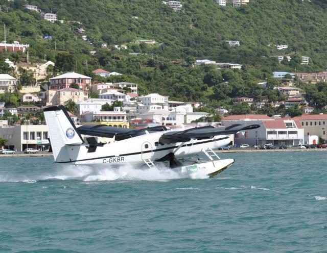 Seaborne Airlines seaplane taking off from Charlotte Amalie harbor, U.S. Virgin Islands.