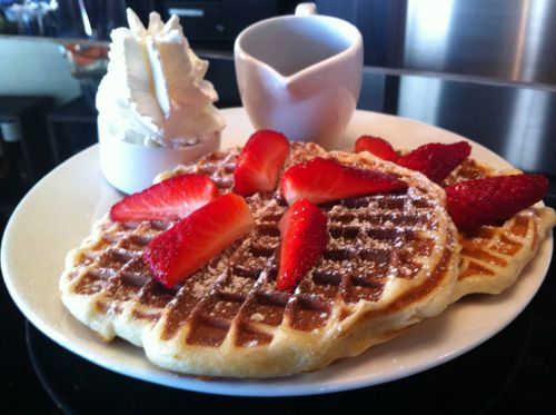 Waffles with strawberries at Chez Marcel in Paris.