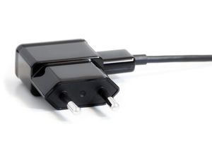 Closeup of an AC power adapter plug isolated