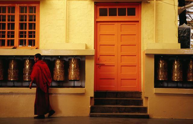 Monk spinning prayer wheels at Tsuglagkhang Temple, McLeod Ganj.
