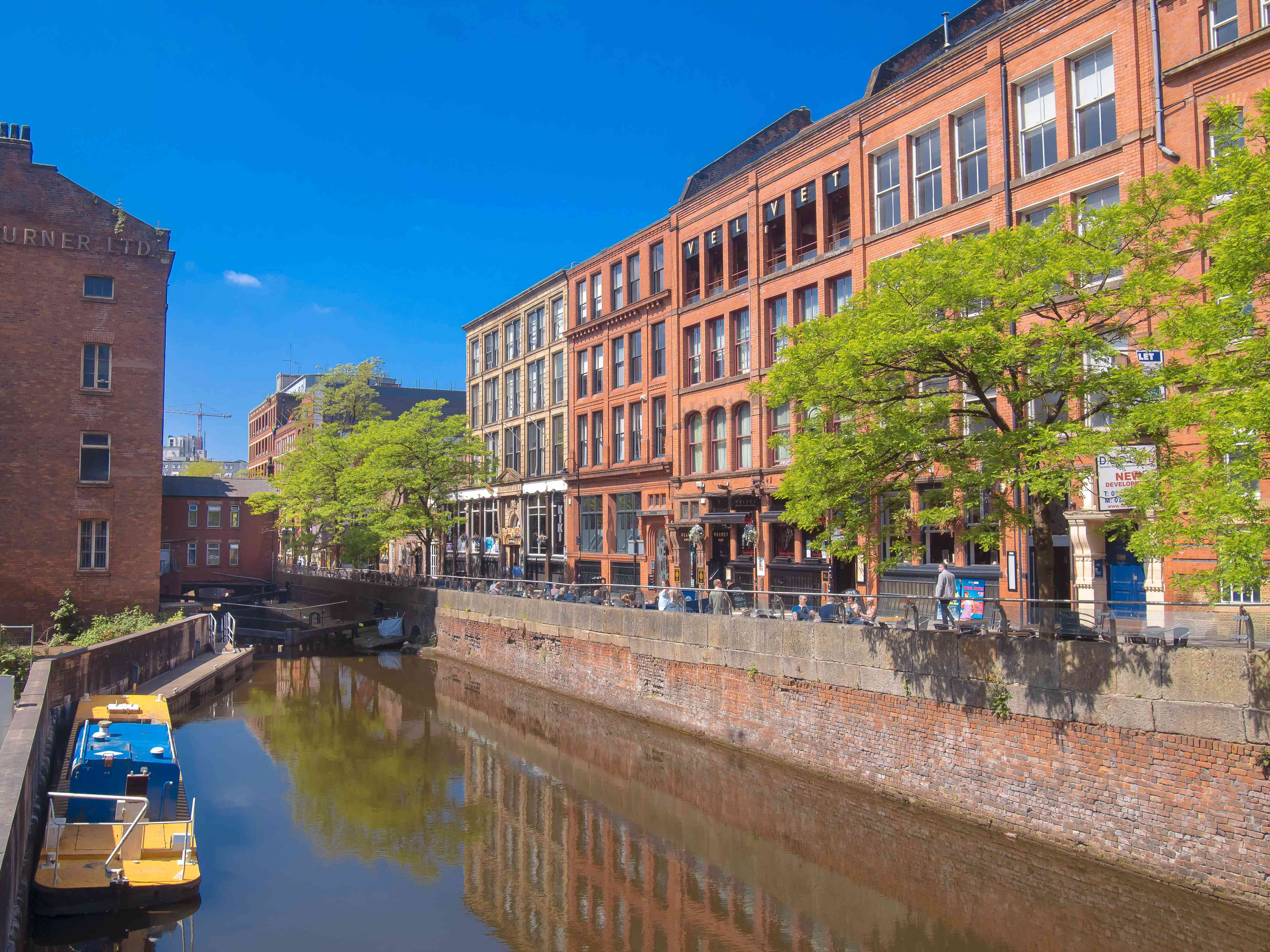 View of a canal and red brick buildings in the Manchester Gay Village