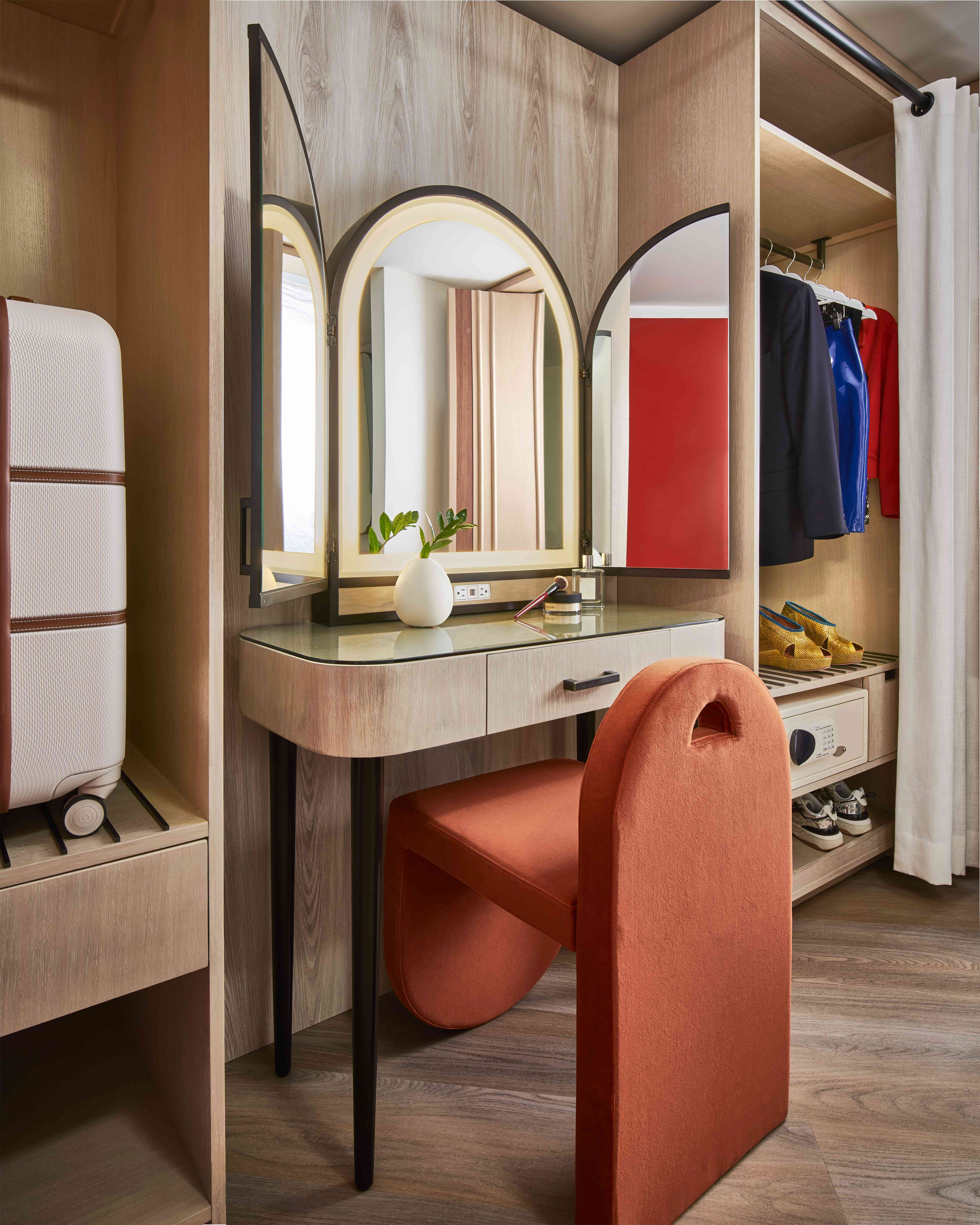 Vanity table with red accent chair at Virgin Hotels Las Vegas