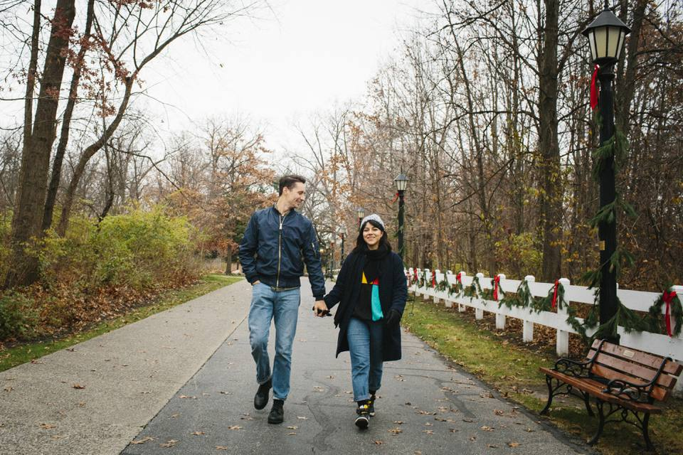 Man and woman walking in Toledo Ohio park holding hands