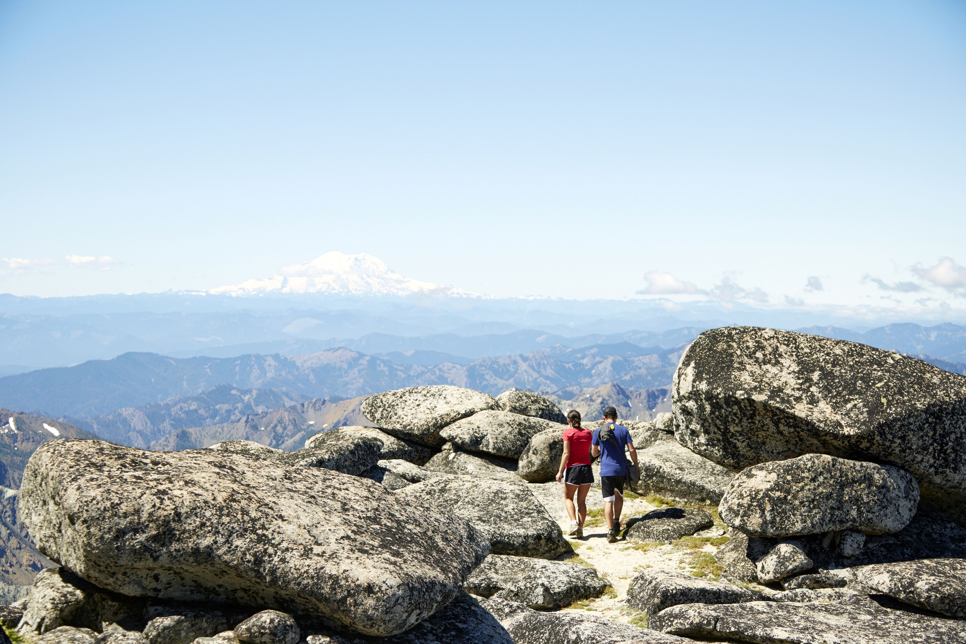 Couple hiking on rocky hilltop