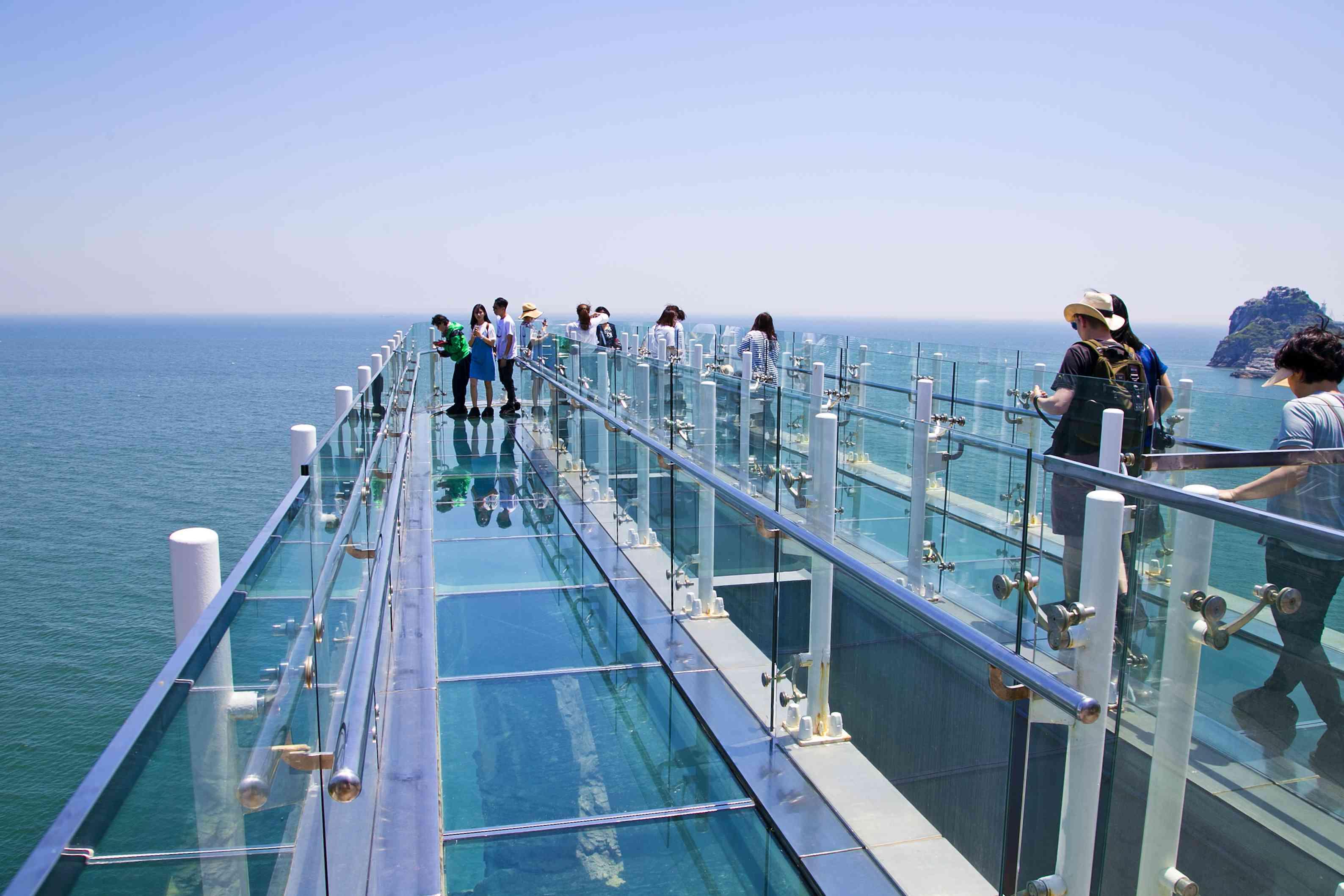 transparent Oryukdo skywalk over the water in Busan city, South Korea