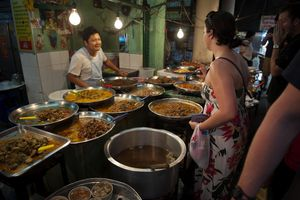 A female tourist ordering food in Thailand