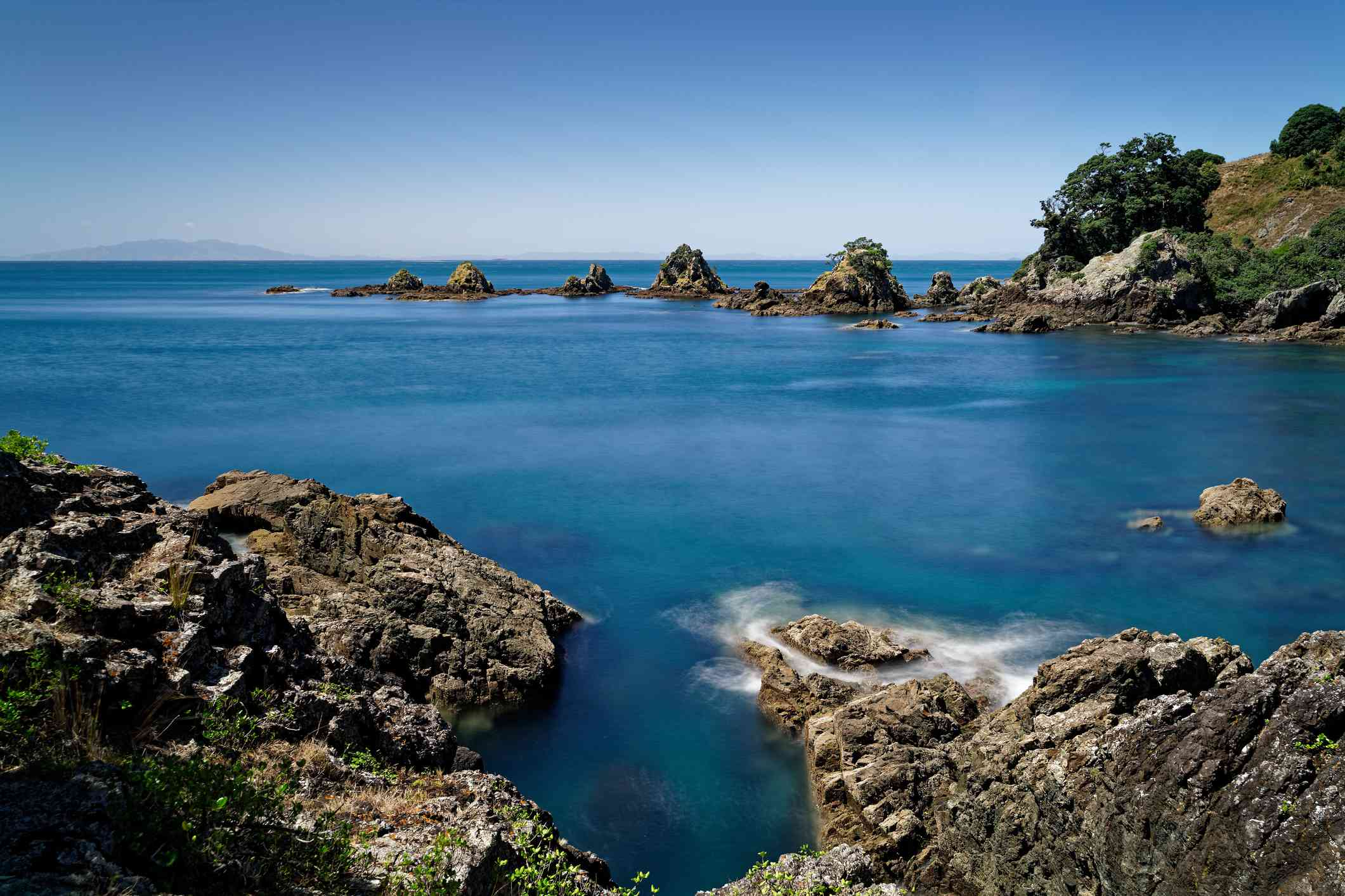 blue sea with rockpools in a bay