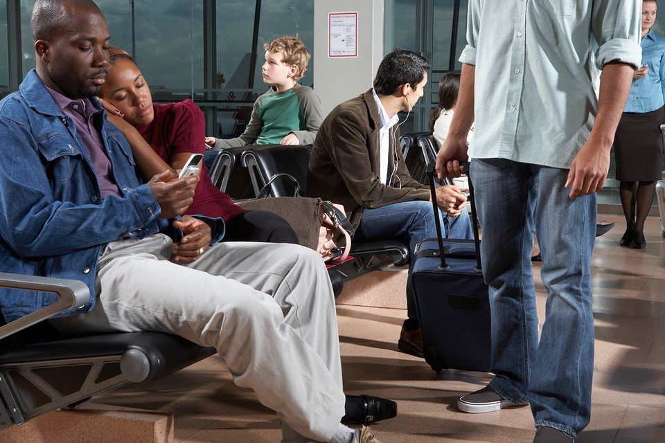 People in airport waiting area