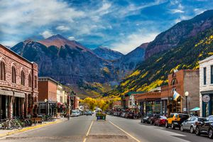 A look down Main Street in Telluride during Peak Autumn Color from the Aspens with a mountain backdrop