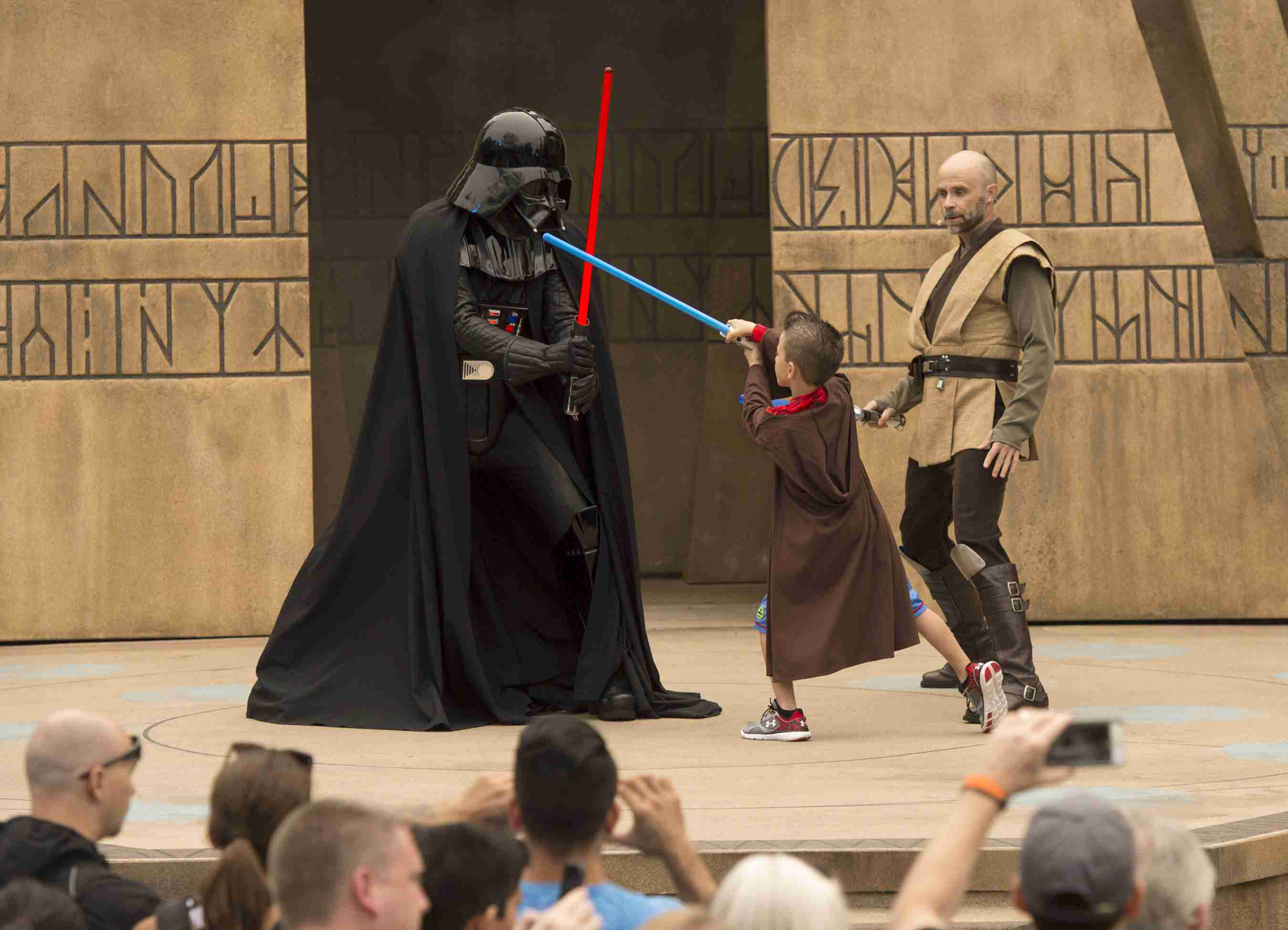 A Jedi-in-training sparring with Darth Vader