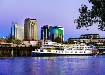 Sacramento skyline and riverfront at dusk