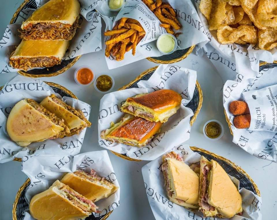 several plates of cuban sandwiches