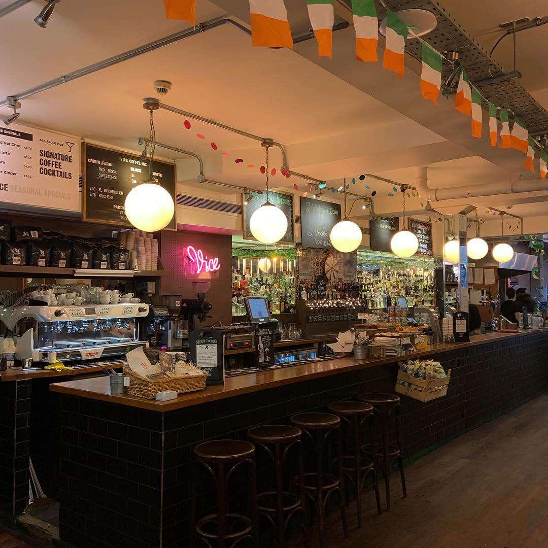 coffee bar and pub with irish flags