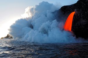 Lava from Puu Oo flowing into ocean on Kalapana Coast, Hawaii Volcanoes National Park, Big Island, Hawaii, USA