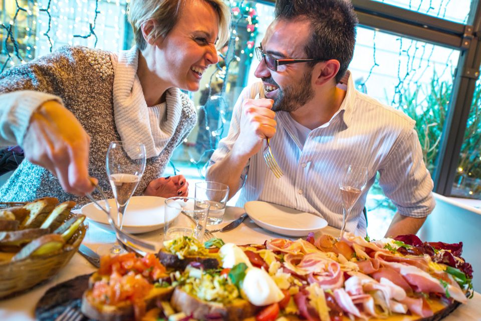 couple having christmas dinner in a restaurant - Restaurants Open For Christmas Dinner