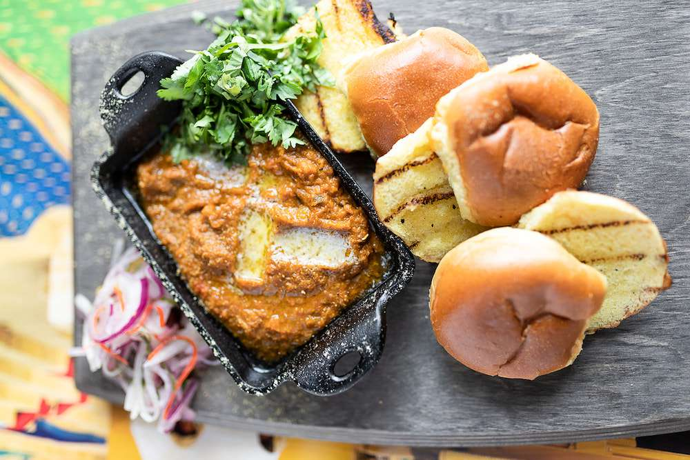curry and breads on a platter