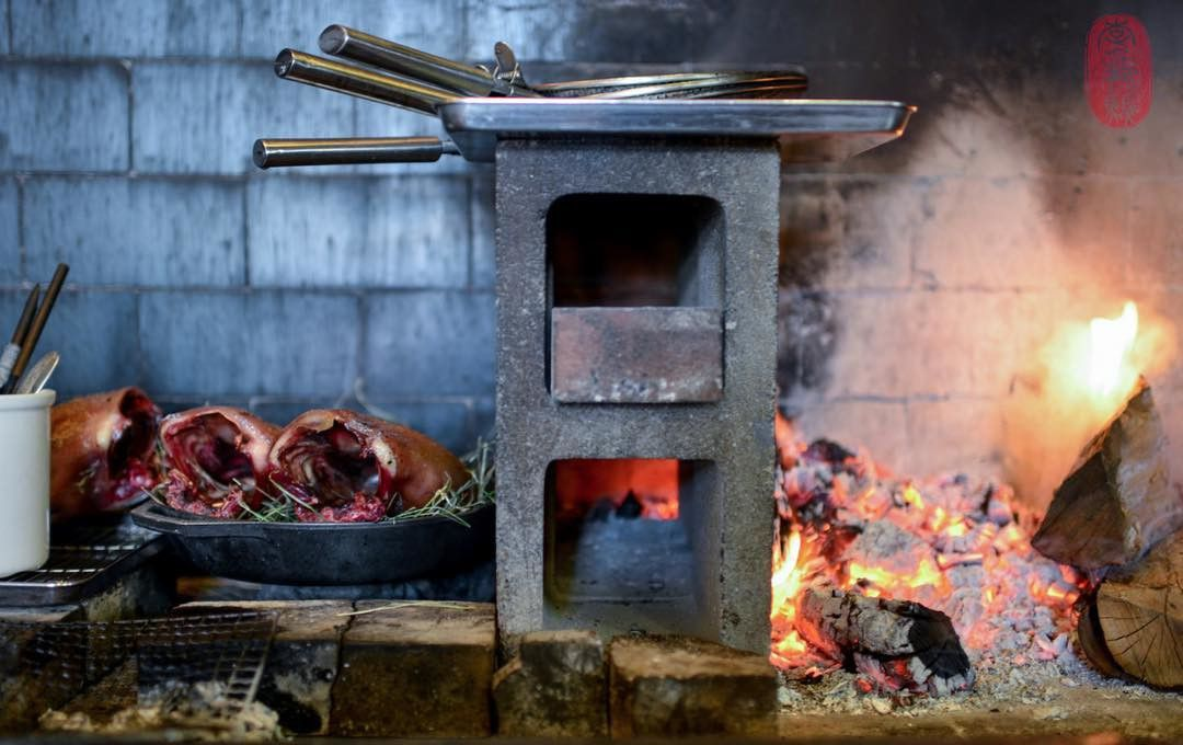 Saison kitchen cooking with a cinder-block
