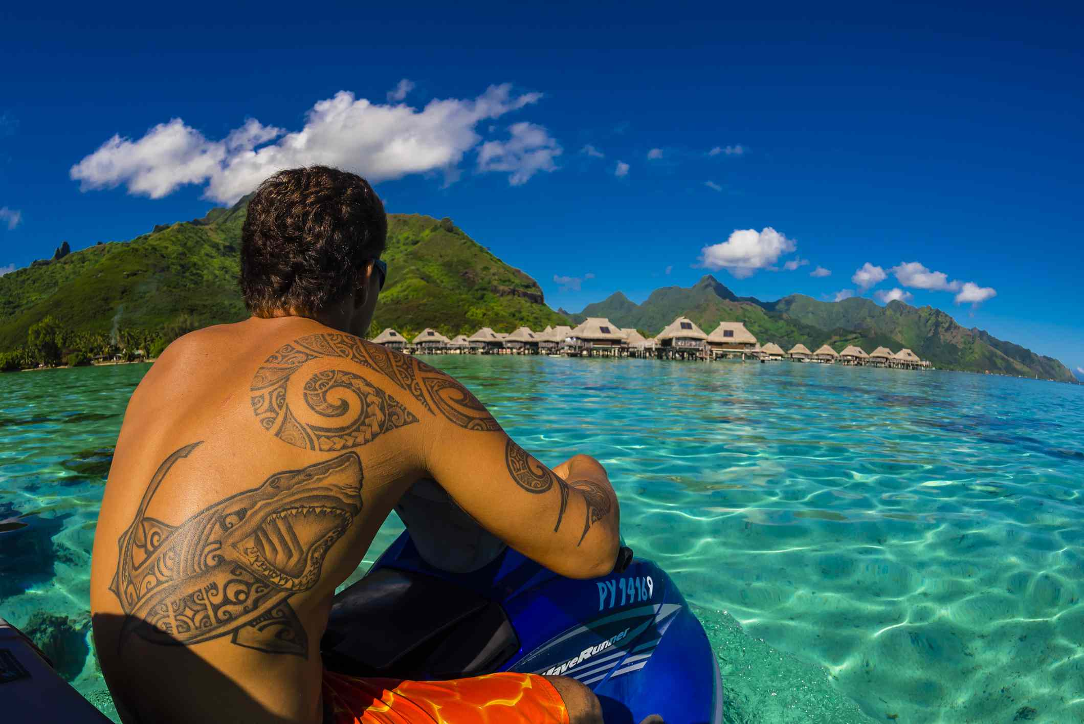 Looking to overwater bungalows in the lagoon (inside the reef) from aboard a jetski, Hilton Moorea L